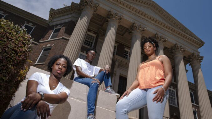 Black campus leaders, Kennedy Coleman, 19, programming chair for the Association of Black Students, left, Abena Marfo, 20, president of the African Student Association and Scotlin Francis, 21, director of Inclusivity for the SMU Housing Unification Board, outside of Dallas Hall on the campus of Southern Methodist University in Dallas, June 12, 2020.(Ben Torres / Special Contributor)