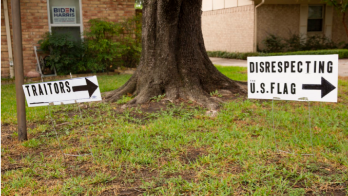 Signs put outside of Brenda Drevicky's home in response to her neighbor putting up signs supporting Trump on Sept. 10, 2020 in Farmers Branch. (Juan Figueroa/Staff Photographer)