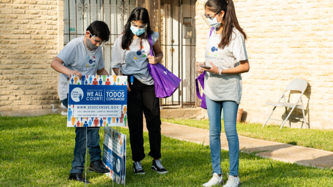 Students canvassing the Pleasant Grove neighborhood