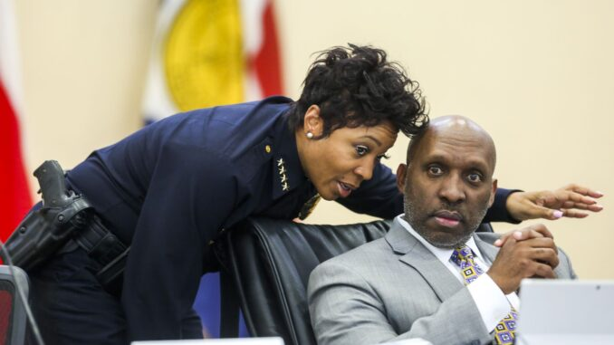 Dallas Police Chief U. Reneé Hall talks to her boss, Dallas City Manager T.C. Broadnax, during a City Council meeting in February 2019. Hall resigned in September and will leave the department at the end of the year.(Shaban Athuman / Staff Photographer)