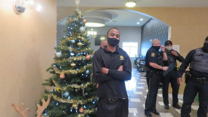 With two life-saving interventions under his belt, DeSoto LaQuinta Hotel Front Desk Supervisor Davion Dawson stands tall, even when surrounded by some of DeSoto's most unflappable first responders.